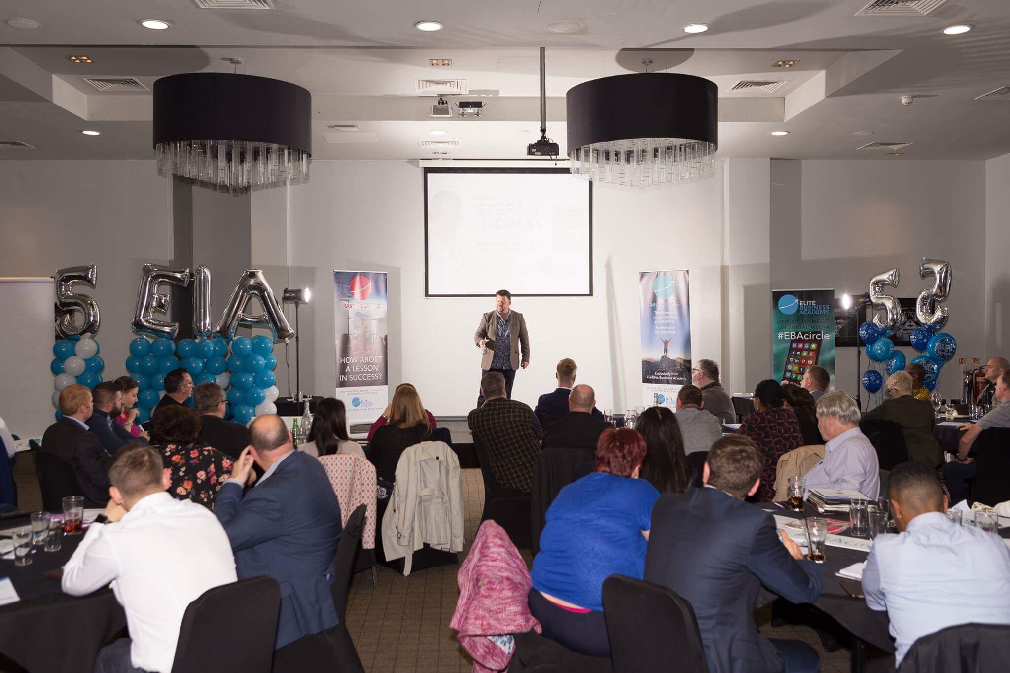 Stefan Thomas speaking at a business networking event